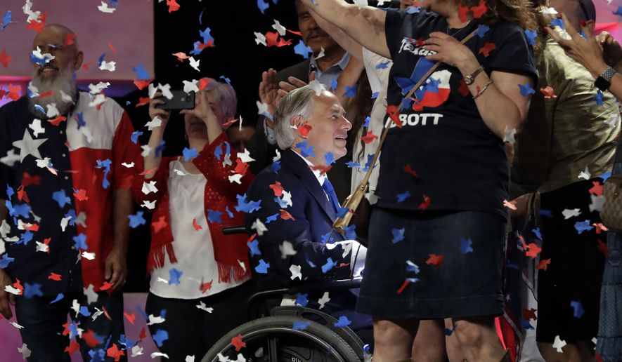 File - In this June 15, 2018 file photo, Confetti falls as Texas Gov. Greg Abbott, center, greets supporters after speaking at the Texas GOP Convention, in San Antonio. The Texas Supreme Court has upheld Houston's refusal to allow the state Republican convention to hold in-person events in the city due to the coronavirus pandemic. The court on Monday, July 13, 2020, dismissed an appeal of a state district judge's denial of a temporary restraining order sought by the state Republican Party. The state GOP convention was scheduled to begin Thursday at Houston's downtown convention center. (AP Photo/Eric Gay File)
