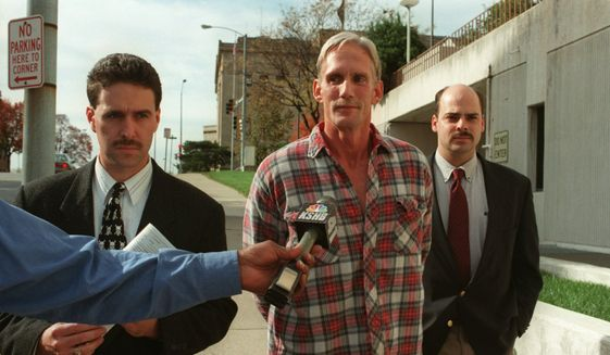 In this 1998 file photo, Wesley Ira Purkey, center, is escorted by police officers in Kansas City, Kan., after he was arrested in connection with the death of 80-year-old Mary Ruth Bales. Purkey was also convicted of kidnapping and killing a 16-year-old girl and is scheduled to be executed on July 15, 2020, in Terre Haute, Ind. (Jim Barcus/The Kansas City Star via AP)