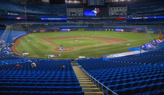 The Toronto Blue Jays play an intrasquad baseball game in Toronto, Friday, July 10, 2020. (Carlos Osorio/The Canadian Press via AP)