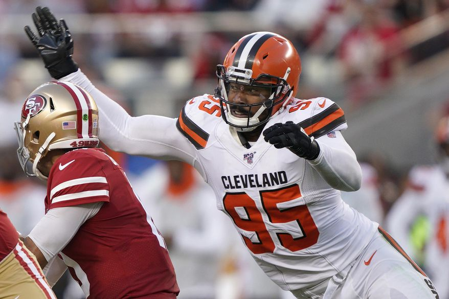 FILE - In this Oct. 7, 2019, file photo, Cleveland Browns defensive end Myles Garrett (95) sacks San Francisco 49ers quarterback Jimmy Garoppolo during the first half of an NFL football game in Santa Clara, Calif. The Browns are closing in on a massive contract extension with Garrett, a person familiar with the negotiations told the Associated Press on Tuesday, July 14, 2020. Garrett, the No. 1 overall pick in 2017 and one of the NFL's premiere edge rushers, and the team could have the deal completed in the next day or so, said the person who spoke on condition of anonymity because of the sensitivity of the talks. (AP Photo/Tony Avelar, File)