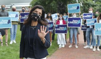 House Speaker Sara Gideon, D-Freeport, greets news media near a polling station, Tuesday, July 14, 2020, in Portland, Maine. (AP Photo/Elise Amendola)