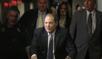 FILE - In this Feb. 24, 2020 file photo, Harvey Weinstein arrives at a Manhattan courthouse for jury deliberations in his rape trial in New York.  A judge has rejected a $19 million settlement between Weinstein and some of his accusers. U.S. District Judge Alvin Hellerstein in Manhattan on Tuesday, July 14,  said Weinstein's accusers in the proposed class-action settlement were too varied to be grouped together.  (AP Photo/Seth Wenig, File)