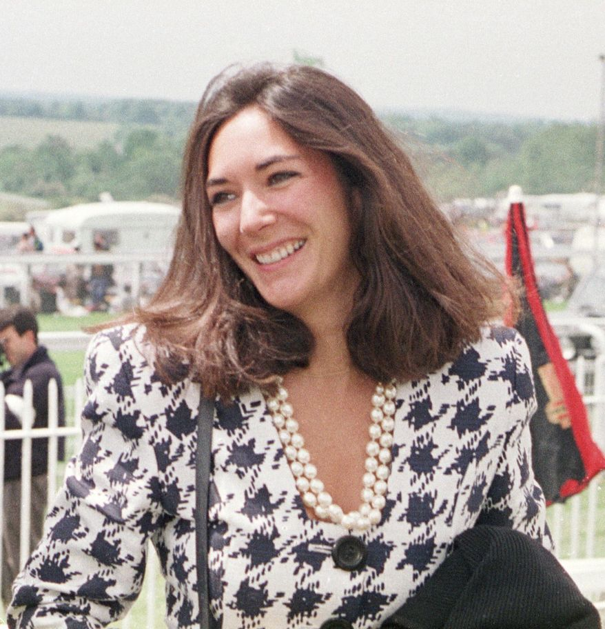 In this June 5, 1991, file photo, British socialite Ghislaine Maxwell arrives at Epsom Racecourse. (Chris Ison/PA via AP) ** FILE **