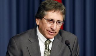 FILE - In this March 5, 2015, file photo then Maricopa County prosecutor Juan Martinez speaks out during a news conference in Phoenix. The Arizona Supreme Court has reinstated sexual harassment allegations in a legal ethics case against Martinez, reversing an earlier decision that threw out claims that Martinez made sexually inappropriate comments to female clerks in the county prosecutor's office. Martinez was fired earlier this year. (AP Photo/Matt York, File)