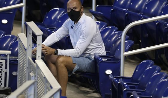 FILE - In this Wednesday, July 8, 2020, file photo, Miami Marlins CEO Derek Jeter watches baseball practice at Marlins Park in Miami. (AP Photo/Lynne Sladky, File)