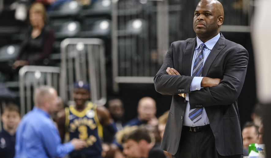 FILE - In this Feb. 25, 2020, file photo, Indiana Pacers coach Nate McMillan watches during the second half of an NBA basketball game against the Charlotte Hornets in Indianapolis. Formulating a plan to get a team ready for the restart of the NBA season wasn't as difficult as one might expect for McMillan. Turns out, he's been through something similar to this before. (AP Photo/AJ Mast, File)