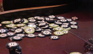 This Feb. 22, 2019 photo shows chips piled in a corner of a table at the Golden Nugget casino in Atlantic City, N.J. between games. New Jersey's casinos and horse tracks won $97.5 million in June, a decline of 65.6% from a year earlier during the final month of being closed due to the coronavirus outbreak. (AP Photo/Wayne Parry)