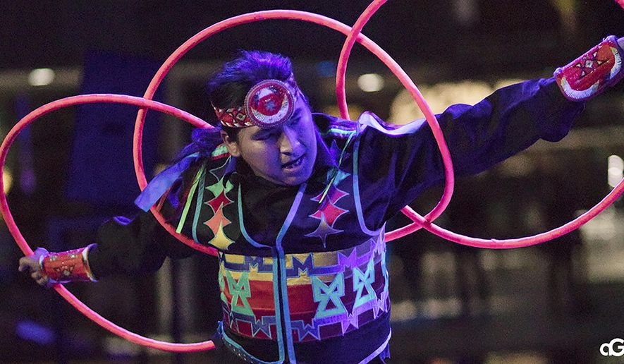 """In this Aug. 10, 2018, photo provided by Anderson Gould Jr. hoop dancer Nakotah LaRance performs at the """"Hip Hop/Electronic: Indigenous Music & Dance of the Grand Performances"""" in Los Angeles. LaRance, a champion hoop dancer who traveled the world performing with Cirque du Soleil, died Sunday, July 12, 2020, after he fell while climbing on an old bridge in Rio Arriba County in New Mexico. He was 30. (Anderson Gould Jr. via AP)"""