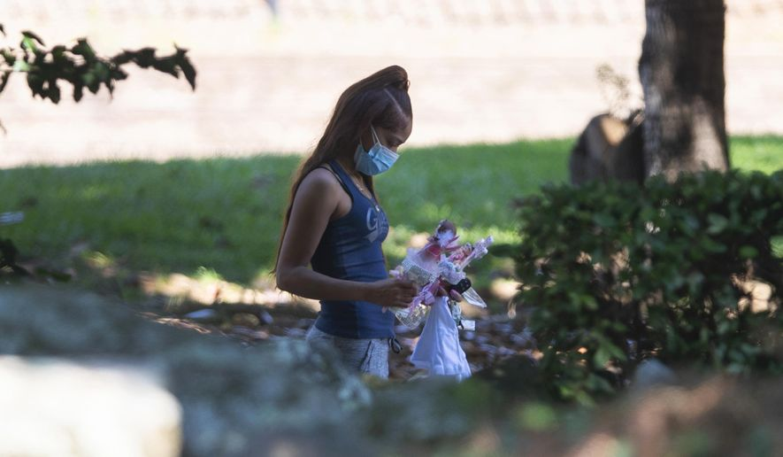 Charmaine Turner walks to a viewing her for 8-year-old daughter Secoriea Turner, who was fatally shot in Atlanta on July 4th near the Wendy's site where Rayshard Brooks was killed the previous month Tuesday, July 14, 2020, in South Fulton, Ga. (AP Photo/John Bazemore)
