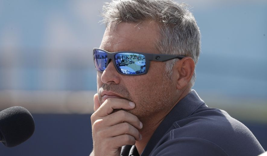 Tampa Bay Rays manager Kevin Cash listens to a question during a news conference after pitchers and catchers reported for spring training baseball camp in Port Charlotte, Florida, FILE. (AP Photo/John Bazemore) ** FILE **