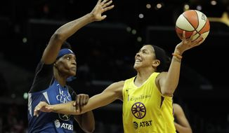"""FILE - In this Aug. 20, 2019, file photo, Minnesota Lynx center Sylvia Fowles, left, fouls Los Angeles Sparks forward Candace Parker during the second half of a WNBA basketball game in Los Angeles. Parker and her 11-year-old daughter are braving the start of an unprecedented WNBA season together in Florida. The Sparks All-Star knows it's a calculated risk to stay in the coronavirus hot spot, where all 12 teams will play games in the WNBA """"bubble"""" of Bradenton. (AP Photo/Chris Carlson, File)"""