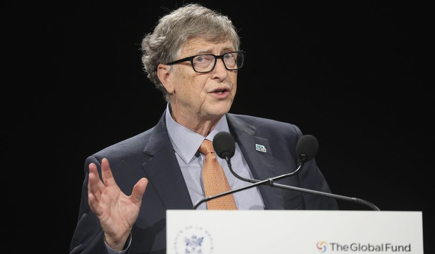 In this Thursday, Oct. 10, 2019, photo, philanthropist and co-chairman of the Bill & Melinda Gates Foundation Bill Gates gestures as he speaks to the audience during the Global Fund to Fight AIDS event at the Lyon's congress hall, central France. (Ludovic Marin/Pool Photo via AP) ** FILE **