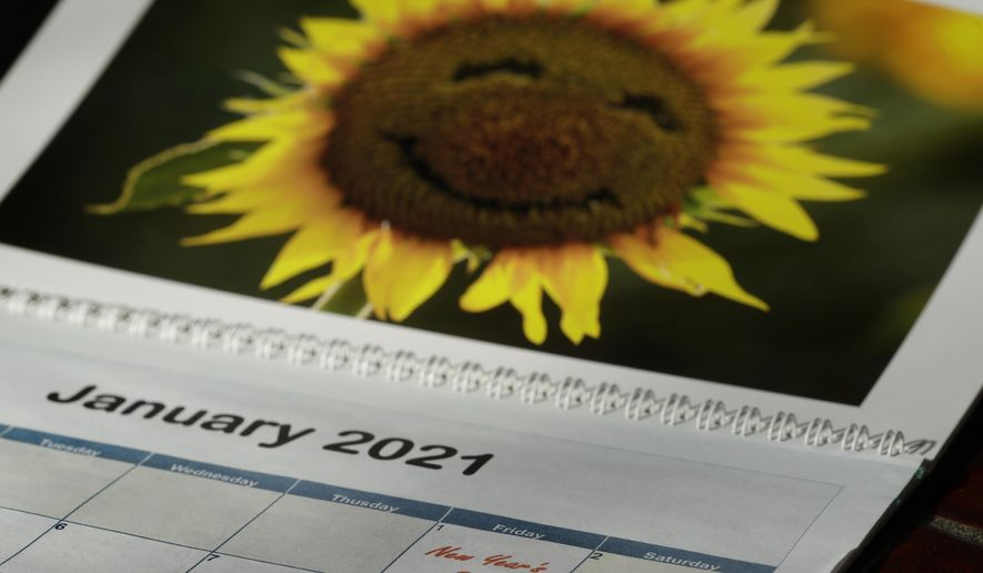 New Year's Day is seen on a 2021 calendar Friday, July 10, 2020, in Overland Park, Kan. 2020 is barely halfway over. That hasn't stopped many people from declaring the year canceled and wishing it would end. (AP Photo/Charlie Riedel)