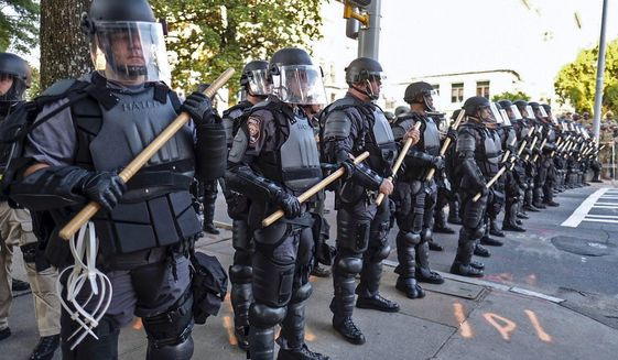 "Police in riot gear stand guard in Atlanta on May 31. The White House now says it is ""pro-safety, pro-police and anti-crime."" (Associated Press)"