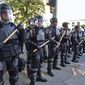 """Police in riot gear stand guard in Atlanta on May 31. The White House now says it is """"pro-safety, pro-police and anti-crime."""" (Associated Press)"""