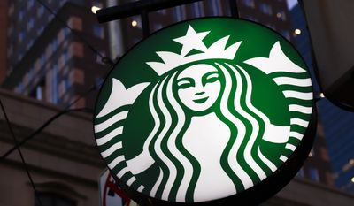 A Starbucks sign outside a Starbucks coffee shop in downtown Pittsburgh.  (AP Photo/Gene J. Puskar, File)