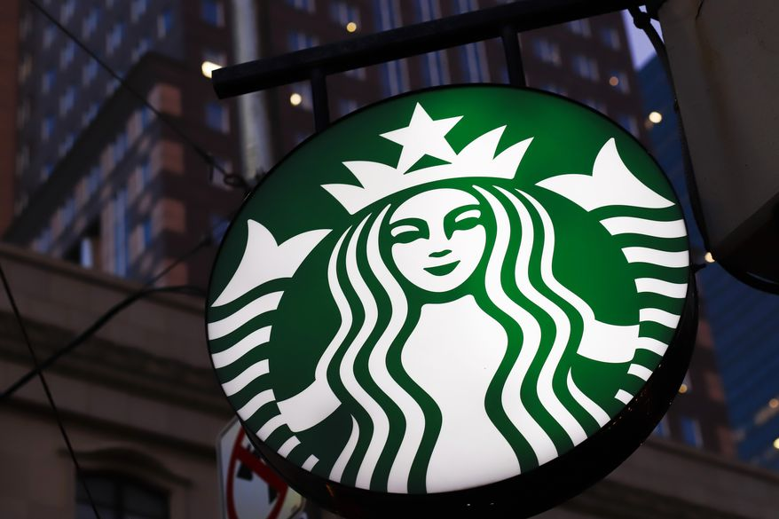 A Starbucks sign outside a Starbucks coffee shop in downtown Pittsburgh.  (AP Photo/Gene J. Puskar, File)