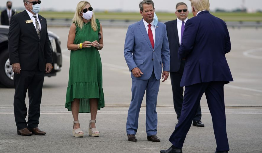 Georgia Gov. Brian Kemp, third from left, greets President Donald arrives at Hartsfield-Jackson International Airport, Wednesday, July 15, 2020, in Atlanta. (AP Photo/Evan Vucci)