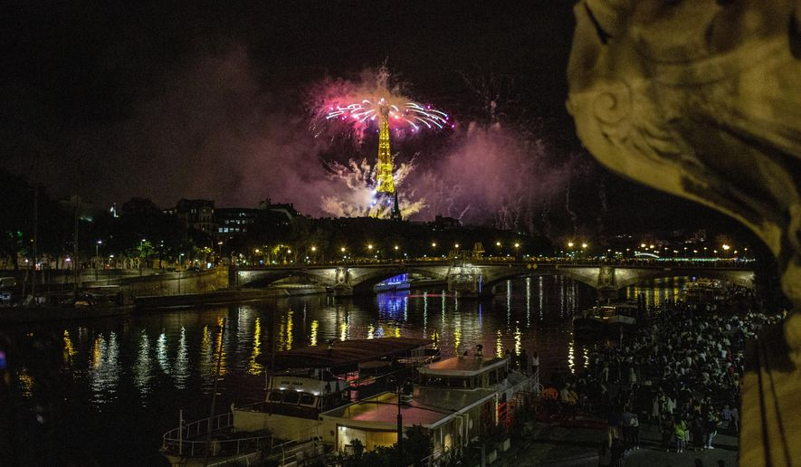 Fireworks illuminate the Eiffel Tower in Paris during Bastille Day celebrations late Tuesday, July 14, 2020. Bastille Day marks the July 14, 1789, storming of the Bastille prison by angry Paris crowds that helped spark the French Revolution. (AP Photo/Rafael Yaghobzadeh)