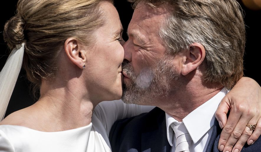 Denmark's Prime Minister Mette Frederiksen marries Bo Tengberg in Magleby Church on Zealand, Denmark, Wednesday July 15, 2020. (Mads Claus Rasmussen/Ritzau Scanpix via AP)