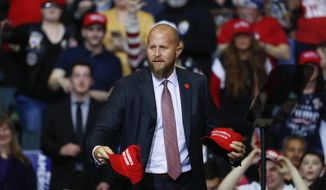"""In this Thursday, March 28, 2019, file photo, Brad Parscale, then-manager of President Donald Trump's reelection campaign, throws """"Make America Great Again,"""" hats to the audience before a rally in Grand Rapids, Mich. (AP Photo/Paul Sancya, File)"""