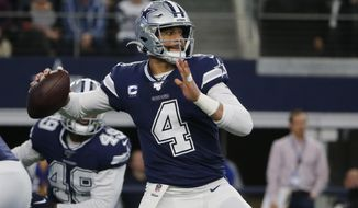 FILE - In this Dec. 15, 2019, file photo, Dallas Cowboys quarterback Dak Prescott (4) looks to throw in the first quarter of an NFL football game against the Los Angeles Rams in Arlington, Texas. Dallas quarterback Dak Prescott and NFL rushing leader Derrick Henry of Tennessee will play whatever becomes of the 2020 season under the one-year franchise tag after failing to reach long-term deals with their teams. Prescott is set to make $31.4 million after earning slightly more than $4 million under his four-year rookie contract. The 2016 NFL Offensive Rookie of the Year negotiated for more than a year without coming to terms on a deal. (AP Photo/Michael Ainsworth, File)