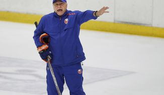 New York Islanders head coach Barry Trotz give instructions during a team practice, Monday, July 13, 2020, at the team's practice facility in East Meadow, N.Y. (AP Photo/Kathy Willens)