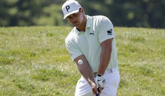 Bryson DeChambeau chips towards a green in the practice area during a practice round for the Memorial golf tournament, Wednesday, July 15, 2020, in Dublin, Ohio. (AP Photo/Darron Cummings)