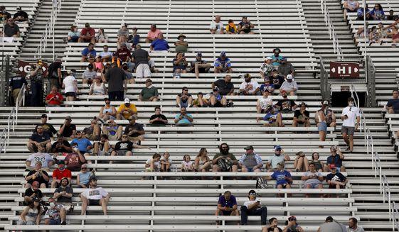 Fans wait for the start of a NASCAR All-Star Open auto race at Bristol Motor Speedway in Bristol, Tenn, Wednesday, July 15, 2020. (AP Photo/Mark Humphrey)