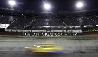 A car runs during a NASCAR All-Star auto race at Bristol Motor Speedway in Bristol, Tenn, Wednesday, July 15, 2020. (AP Photo/Mark Humphrey)