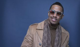 """In this Dec. 10, 2018, file photo Nick Cannon poses for a portrait in New York. Cannon's """"hateful speech"""" and anti-Semitic conspiracy theories led ViacomCBS to cut ties with the performer, the media giant said. """"ViacomCBS condemns bigotry of any kind and we categorically denounce all forms of anti-Semitism,"""" the company said in a statement Tuesday, July 14, 2020. It is terminating its relationship with Cannon, ViacomCBS said. (Photo by Amy Sussman/Invision/AP, File)"""