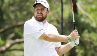 Shane Lowry, of Ireland, watches his drive on the second tee during the second round of the Workday Charity Open golf tournament, Friday, July 10, 2020, in Dublin, Ohio. (AP Photo/Darron Cummings)