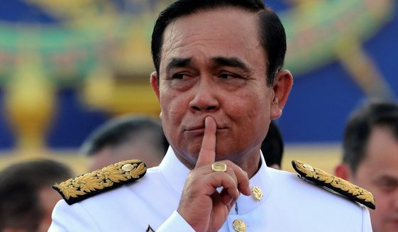 Thai Prime Minister Prayuth Chan-ocha appears to have an upper hand over his opponents after imposing restrictions to contain COVID-19 and navigating diplomatic relations between the U.S. and China. (Associated Press/File)