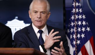 USA Today says that Peter Navarro's column about Dr. Anthony Fauci that it solicited and published did not meet its fact-checking standards. (AP Photo/Alex Brandon, File)