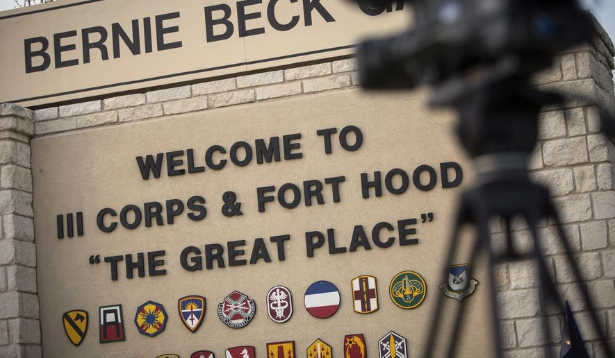 In this April 2, 2014, file photo, members of the media wait outside of the Bernie Beck Gate, an entrance to the Fort Hood military base in Fort Hood, Texas. (AP Photo/Tamir Kalifa, File)  **FILE**