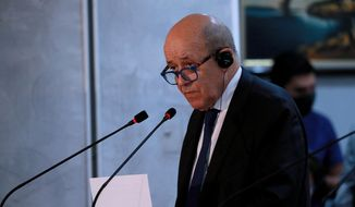 French Foreign Minister Jean-Yves Le Drian attends a news conference with Iraq counterpart Fouad Hussein following their meeting in Baghdad, Iraq, Thursday, July 16, 2020. (AP Photo/Hadi Mizban)