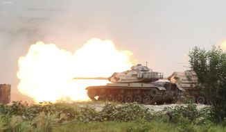 Taiwan's M60A3 Patton main battle tanks fire during the 36th Han Kung military exercises in Taichung City, central Taiwan, Thursday, July 16, 2020. (AP Photo/Chiang Ying-ying) ** FILE **