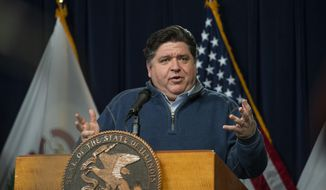 FILE - In this April 17, 2020, file photo, Illinois Gov. J.B. Pritzker speaks during his daily coronavirus news conference in Chicago. Pritzker took the unusual step Thursday, July 16, of preemptively filing a lawsuit to ensure school children wear face coverings to prevent the spread of the coronavirus when schools reopen in a few weeks. (Tyler LaRiviere/Chicago Sun-Times via AP, File)