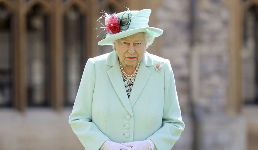 Britain's Queen Elizabeth looks on after awarding Captain Sir Thomas Moore his knighthood during a ceremony at Windsor Castle in Windsor, England, Friday, July 17, 2020. . (Chris Jackson/Pool Photo via AP)  **FILE**