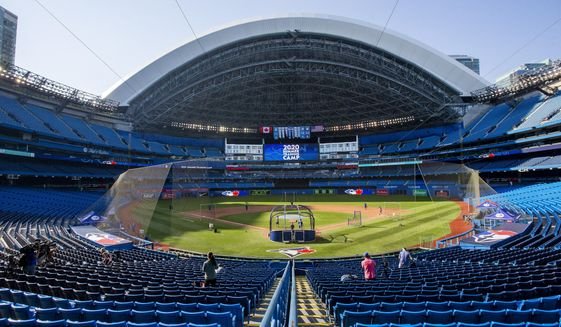 The Toronto Blue Jays take batting practice before an intrasquad baseball game in Toronto on Thursday, July 9, 2020. (Carlos Osorio/The Canadian Press via AP)