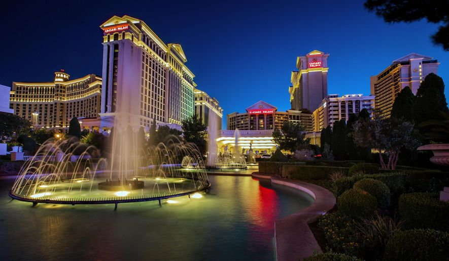 FILE - This June 23, 2019, file photo shows Caesars Palace in Las Vegas. A $17.3 billion buyout creating the world's biggest casino company has final regulatory approval. The New Jersey state Casino Control Commission voted Friday, July 17, 2020 to let Nevada-based Eldorado Resorts acquire Caesars Entertainment Corp. (L.E. Baskow/Las Vegas Review-Journal via AP)
