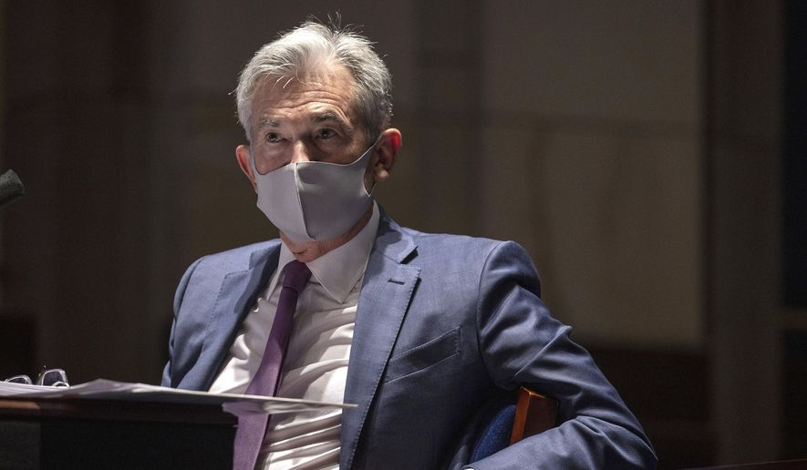 FILE - In this June 30, 2020 file photo, Federal Reserve Chair Jerome Powell testifies during a House Financial Services Committee hearing on the coronavirus response on Capitol Hill in Washington.  The Federal Reserve has opened one of its lending programs to nonprofit groups, including hospitals, educational institutions, and social service organizations. The Fed said Friday, July 17,  that its Main Street Lending Program, which is targeted to mid-sized businesses, will now extend credit to nonprofits with at least 10 employees and endowments of less than $3 billion. (Tasos Katopodis/Pool via AP, File)
