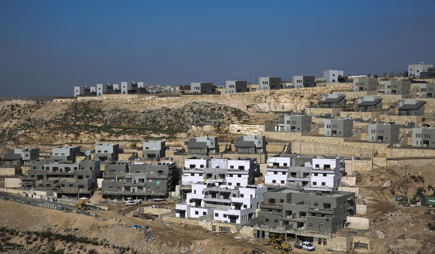 This Tuesday, Jan. 1, 2019, file photo, shows a new housing project in the West Bank settlement of Naale. Peter Beinart, an influential American commentator, has shocked the Jewish establishment and Washington policy-making circles by breaking a long-standing taboo: He has endorsed the idea of a democratic entity of Jews and Palestinians living with equal rights between the Jordan River and the Mediterranean. (AP Photo/Ariel Schalit, File)