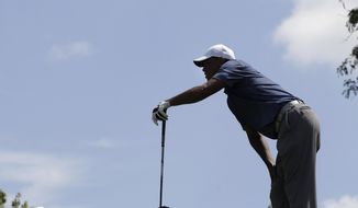 Tiger Woods watches his shot from the fifth tee during the second round of the Memorial golf tournament, Friday, July 17, 2020, in Dublin, Ohio. (AP Photo/Darron Cummings)