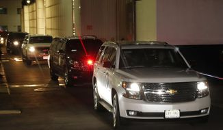 An SUV leads a caravan carrying Emilio Lozoya, former head of Mexico's state-owned oil company Pemex, as it departs from the Benito Suarez International airport in Mexico City, early Friday, July 17 2020. Lozoya, who was arrested in February by Spanish police on an international warrant issued by Mexico, dropped his extradition fight and agreed to return to Mexico to cooperate in corruption investigations, according to Attorney General Alejandro Gertz Manero. (AP Photo/Marco Ugarte)