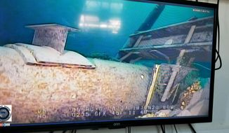 FILE - This June 2020 file photo, shot from a television screen provided by the Michigan Department of Environment, Great Lakes, and Energy shows damage to anchor support EP-17-1 on the east leg of the Enbridge Line 5 pipeline within the Straits of Mackinac in Michigan. Michigan sought a pledge Friday, July 17, 2020 from Enbridge Inc. to cover costs that would arise if oil were to leak from its dual pipelines that extend across a channel linking two of the Great Lakes.  (Michigan Department of Environment, Great Lakes, and Energy via AP File)