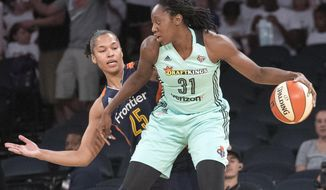 """FILE - In this July 19, 2017, file photo, New York Liberty center Tina Charles (31) drives to the basket against Connecticut Sun forward Alyssa Thomas (25) during the first half of a WNBA basketball game in New York. Washington Mystics forward Tina Charles was medically excused for the season by an independent panel of doctors the team announced Friday, July 17, 2020.Charles, who came over to the Mystics in an offseason trade, wrote in The Players Tribune on Friday that she has a condition called extrinsic asthma that impacts her immune system and would make """"playing during a pandemic a very risky and dangerous proposition."""" (AP Photo/Mary Altaffer, File)"""