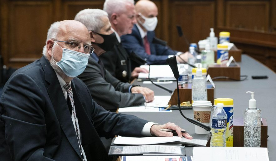 In this Tuesday, June 23, 2020, file photo, Dr. Robert Redfield, director of the Centers for Disease Control and Prevention, left, listens during a House Committee on Energy and Commerce on the Trump administration's response to the COVID-19 pandemic on Capitol Hill in Washington. (Sarah Silbiger/Pool via AP) ** FILE **