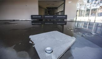 Rogers Place, home of the Edmonton Oilers NHL hockey club, is damaged  following flooding from a storm in Edmonton, Alberta, Friday July 17, 2020. (Jason Franson/The Canadian Press via AP)