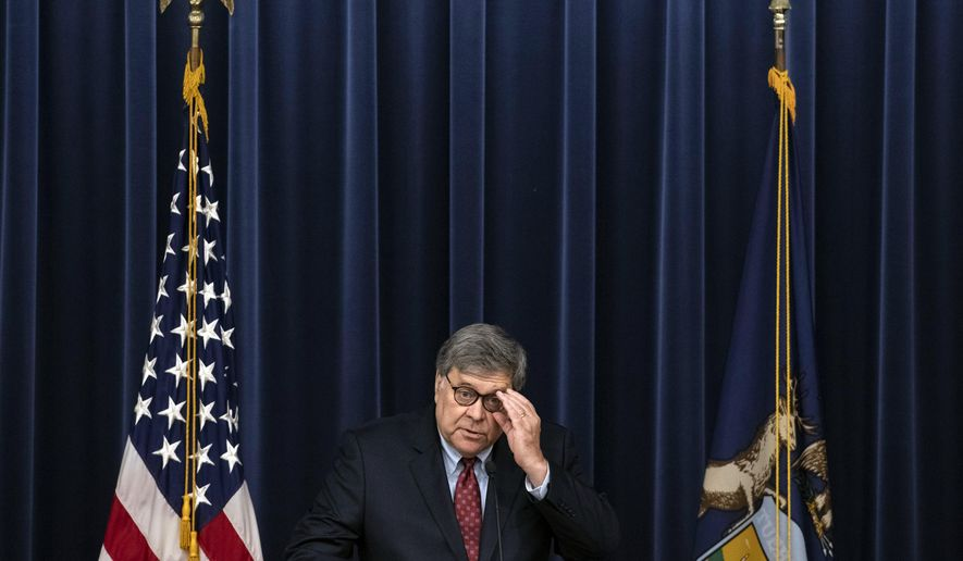 U.S. Attorney General William Barr speaks at the Gerald R. Ford Presidential Museum in Grand Rapids, Mich., Thursday, July 16, 2020. The United States has become overly reliant on Chinese goods and services, including face masks, medical gowns and other protective equipment designed to curb the spread of the coronavirus, Attorney General Barr said Thursday. (Nicole Hester/Mlive.com/Ann Arbor News via AP)